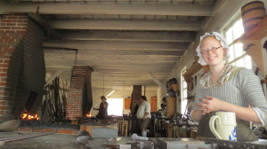 This young lady is a blacksmith. She showed us the work of the shop including locks, ladles, axe blades and swords.